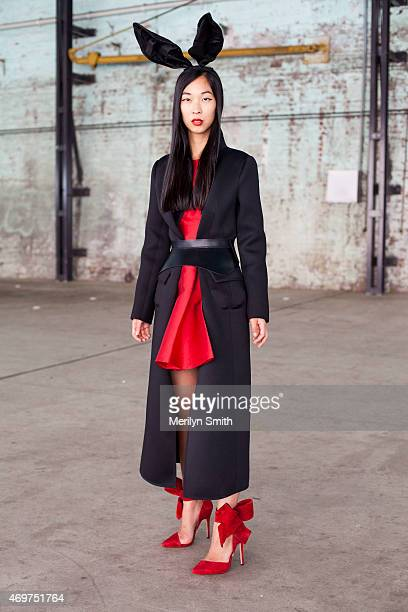 Fashion Blogger Cissy Zhang wears an Aminah Aedul Jillil shoes Kate Spade dress and a Georgio Armani coat at MercedesBenz Fashion Week Australia 2015...