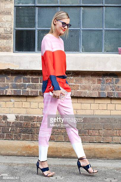 Fashion Blogger Dasha Gold wears a SportMax Max Mara top and trousers Mode Collective shoes Sarahbag Clutch Furla pouch and Prism sunglasses at...