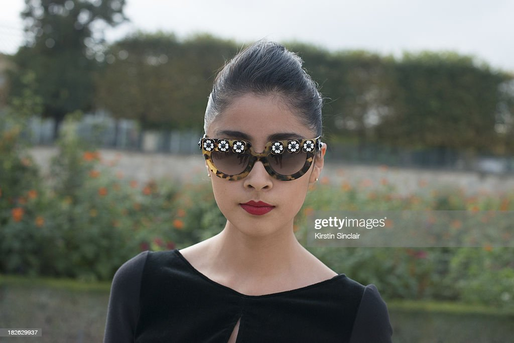 Fashion blogger Deni Elias wears an Elle Saab jumpsuit with Prada sunglasses on day 7 of Paris Fashion Week Spring/Summer 2014, Paris September 30, 2013 in Paris, France.