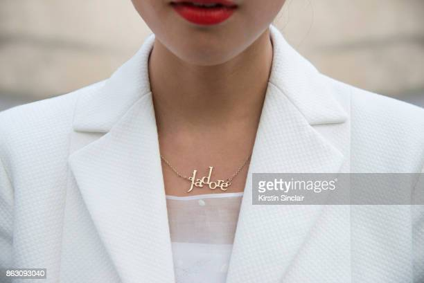 Fashion blogger Dennie Elias wears a Dior jacket dress and necklace day 1 of Paris Womens Fashion Week Spring/Summer 2018 on September 26 2017 in...