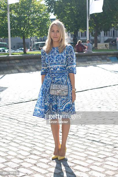 Fashion Blogger Diana Bell Heather wears a Dolce and Gabbana dress Christian Louboutin shoes and Chanel bag on day 3 during London Fashion Week...