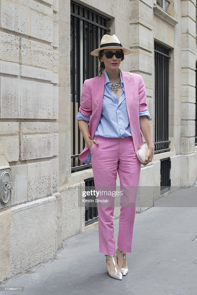 Fashion blogger Diana Enciu wears a Marsay suit, Tommy Hilfiger shirt, J Crew necklace Ray Ban sunglasses and Zara shoes on day 2 of Paris Collections: Womens Haute Couture on July 02, 2013 in Paris, France.