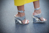 Fashion blogger Dodo Said is seen wearing a Porsche design dress and Bcbg shoes after Prada show on June 22 2014 in Milan Italy
