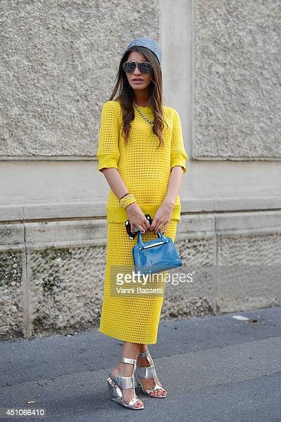 Fashion blogger Dodo Said is seen wearing a Porsche design dress and bag and Bcbg shoes after Prada show on June 22 2014 in Milan Italy
