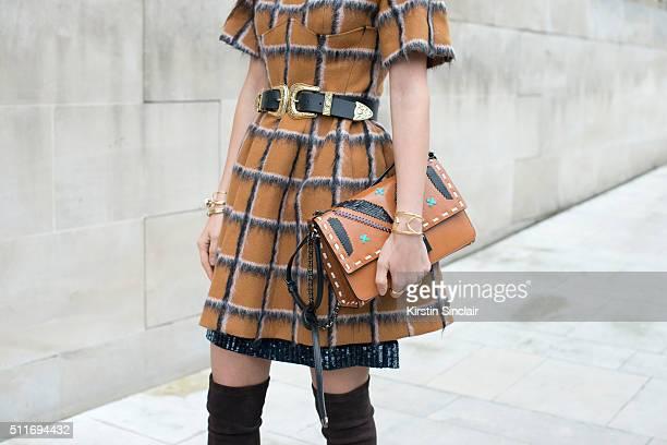 Fashion blogger Doina Ciobanu wears a Dior dress BLow The Belt belt Jimmy Choo boots and bag on day 3 during London Fashion Week Autumn/Winter...