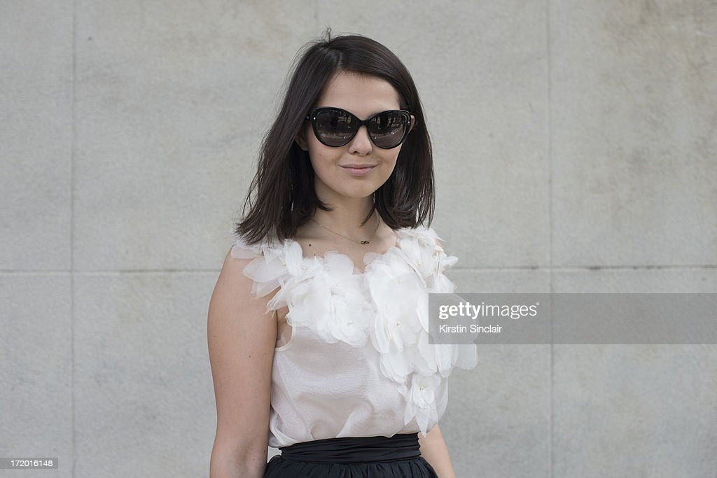 Fashion Blogger Doina Ciobanu wears a Rhea Costa skirt and top and Dior sunglasses on day 4 of Paris Collections: Men on June 29, 2013 in Paris, France.