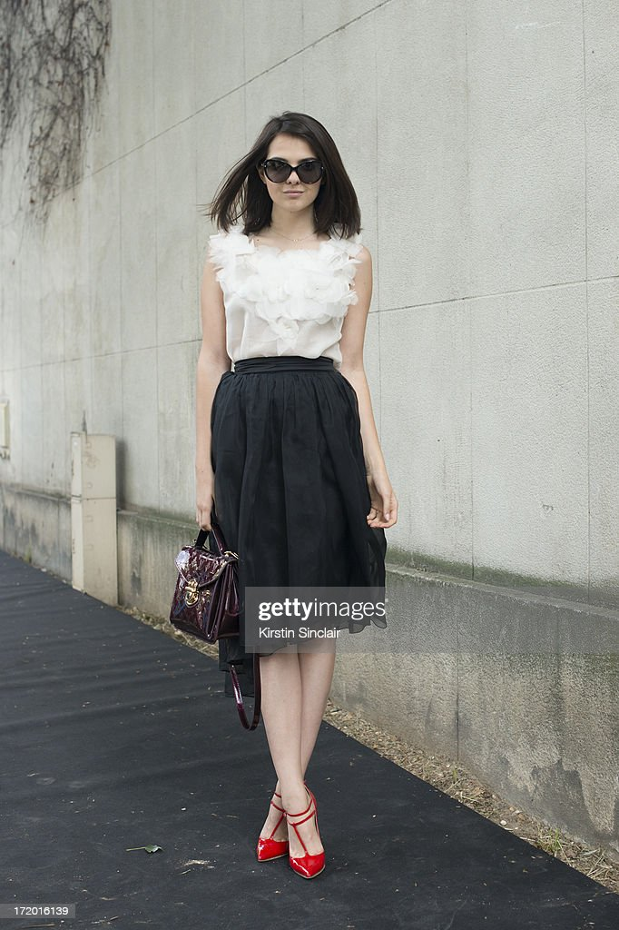 Fashion Blogger Doina Ciobanu wears Christian Louboutin shoes, Rhea Costa skirt and top, Louis Vuitton bag and Dior sunglasses on day 4 of Paris Collections: Men on June 29, 2013 in Paris, France.