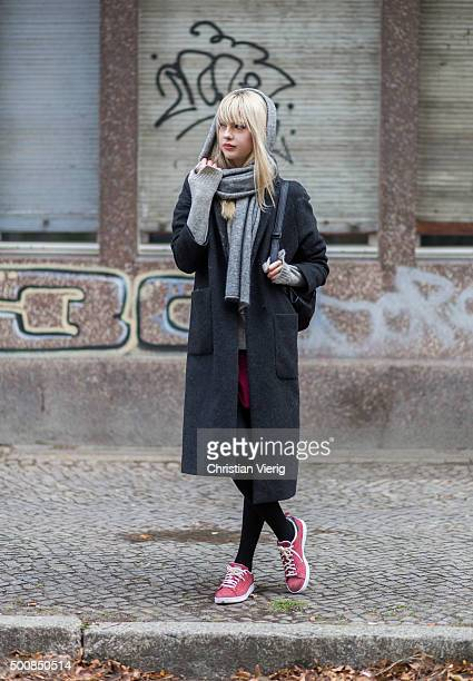 Fashion Blogger Ebba Zingmark wearing skirt Motel Rocks shoes Adidas coat Brixtol sweater Promod scarf other stories on December 10 2015 in Berlin...