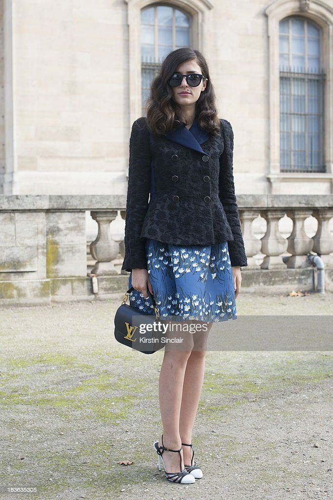 Fashion blogger Eleanora Carisi wearing a Valentino dress, Louis Vuitton jacket and bag and Sergio Rossi shoes on day 9 of Paris Fashion Week Spring/Summer 2014, Paris October 02, 2013 in Paris, France.