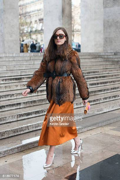 Fashion blogger Eleonora Carisi wears Bluemarine dress and coat Fendi bag Gucci sunglasses Paula Cademartori shoes on day 2 during Paris Fashion Week...