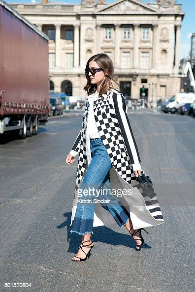 Fashion Blogger Eleonora Carisi wears Tibi jeans Celine sunglasses Valentino jacket and bag and Jimmy Choo shoes on day 8 during Paris Fashion Week...