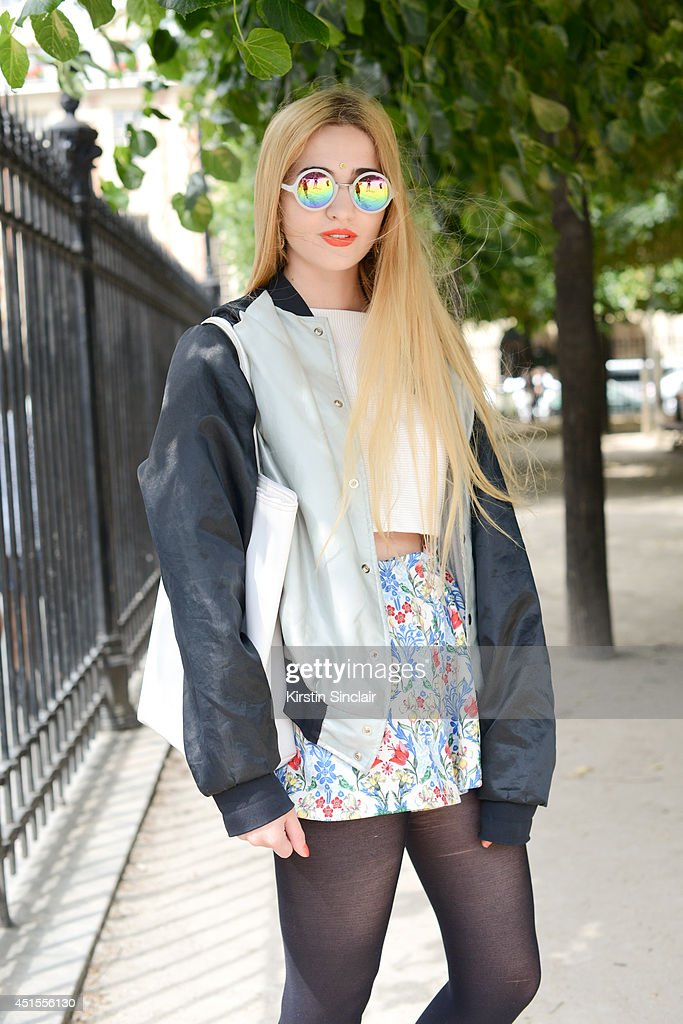 Fashion blogger Elisa Baudoin wearing Asos skirt and sunglasses, H and M top, vintage jacket and a Lacoste bag on day 1 of Paris Collections: Men on June 25, 2014 in Paris, France.