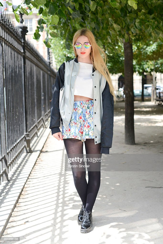 Fashion blogger Elisa Baudoin wearing Asos skirt and sunglasses, Vagabond shoes, H and M top, vintage jacket and a Lacoste bag on day 1 of Paris Collections: Men on June 25, 2014 in Paris, France.