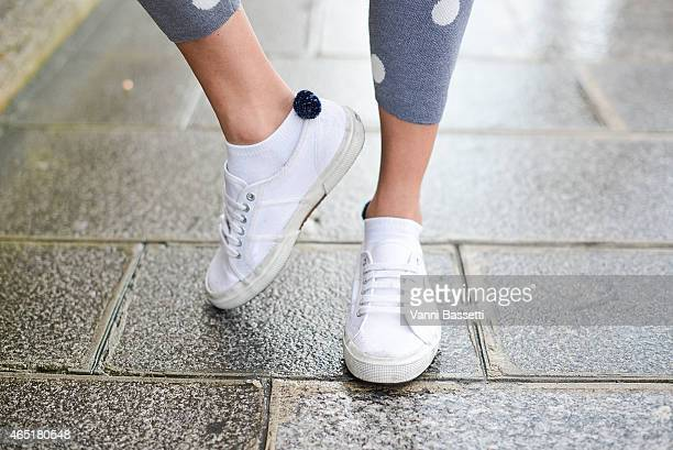 Fashion blogger Elizabeth Minett poses wearing a Asilio pants and Superga shoes on March 3 2015 in Paris France