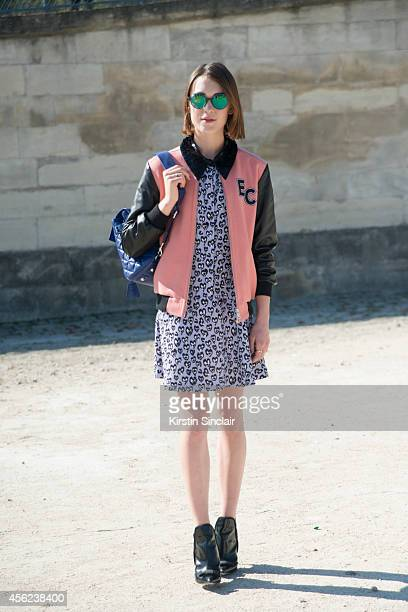 Fashion Blogger Ella Catliff is wearing a Whistles jacket Sandro dress Gianvitto Rossi boots Mulberry bag and Kyte sunglasses on day 4 of Paris...