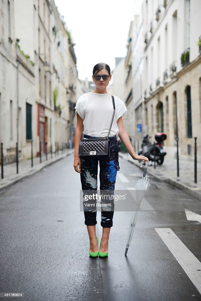Fashion blogger Elvira Abasova poses wearing an Iro top, Tibi pants, Violavinca shoes, Chanel clutch and Armani sunglasses before Fred Sathal show on July 6, 2014 in Paris, France.