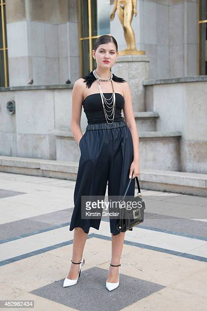 Fashion Blogger Elvira Abasova wearing a Roger Vivier bag Jimmy Choo shoes Sandro trousers and Toi et Moi necklace day 3 of Paris Haute Couture...
