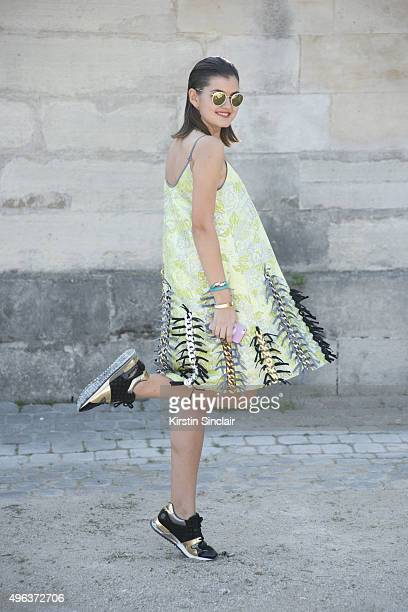 Fashion Blogger Elvira Abasova wears an Anna K dress Rayban sunglasses and Louis Vuitton shoes on day 5 during Paris Fashion Week Spring/Summer...