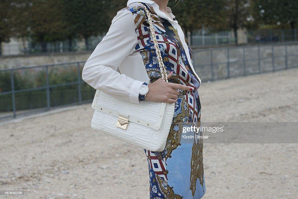 Fashion blogger Elvira Abasova wears an Asli Filiuta dress and Givenchy bag on day 7 of Paris Fashion Week Spring/Summer 2014, Paris September 30, 2013 in Paris, France.