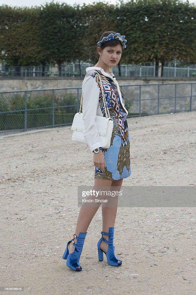 Fashion blogger Elvira Abasova wears Asli Filiuta dress, Givenchy bag, Kat Maconie shoes and a Masterpiece headpiece on day 7 of Paris Fashion Week Spring/Summer 2014, Paris September 30, 2013 in Paris, France.