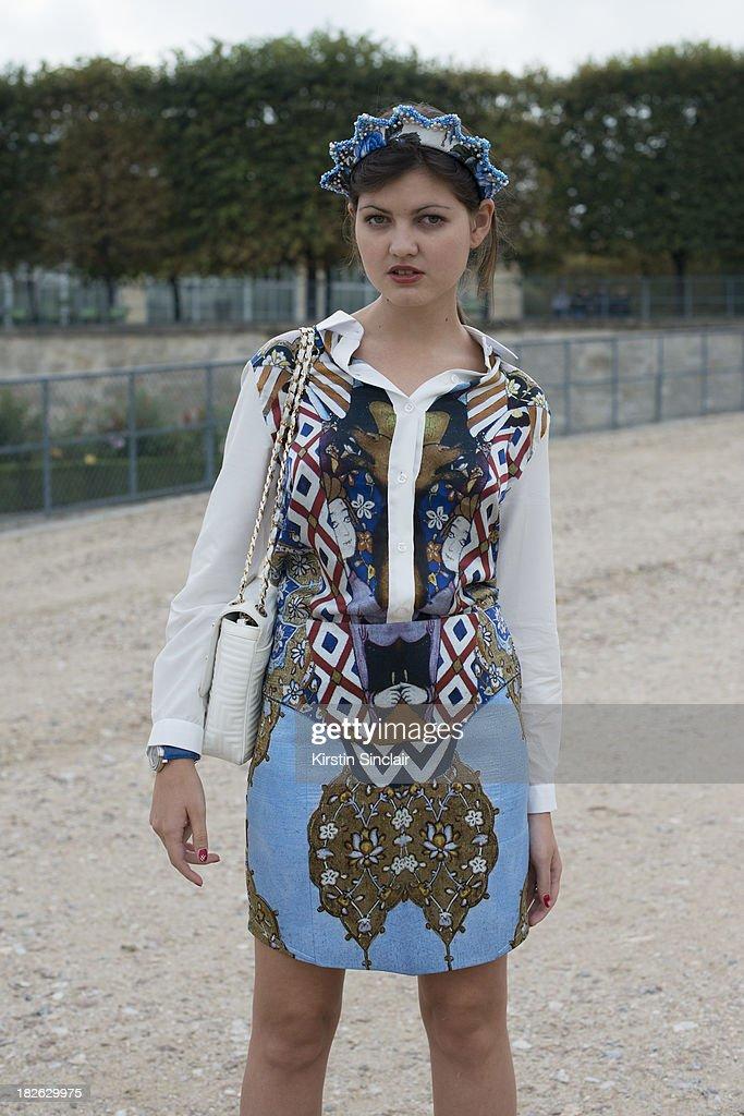 Fashion blogger Elvira Abasova wears Asli Filiuta dress, Givenchy bag and a Masterpiece headpiece on day 7 of Paris Fashion Week Spring/Summer 2014, Paris September 30, 2013 in Paris, France.