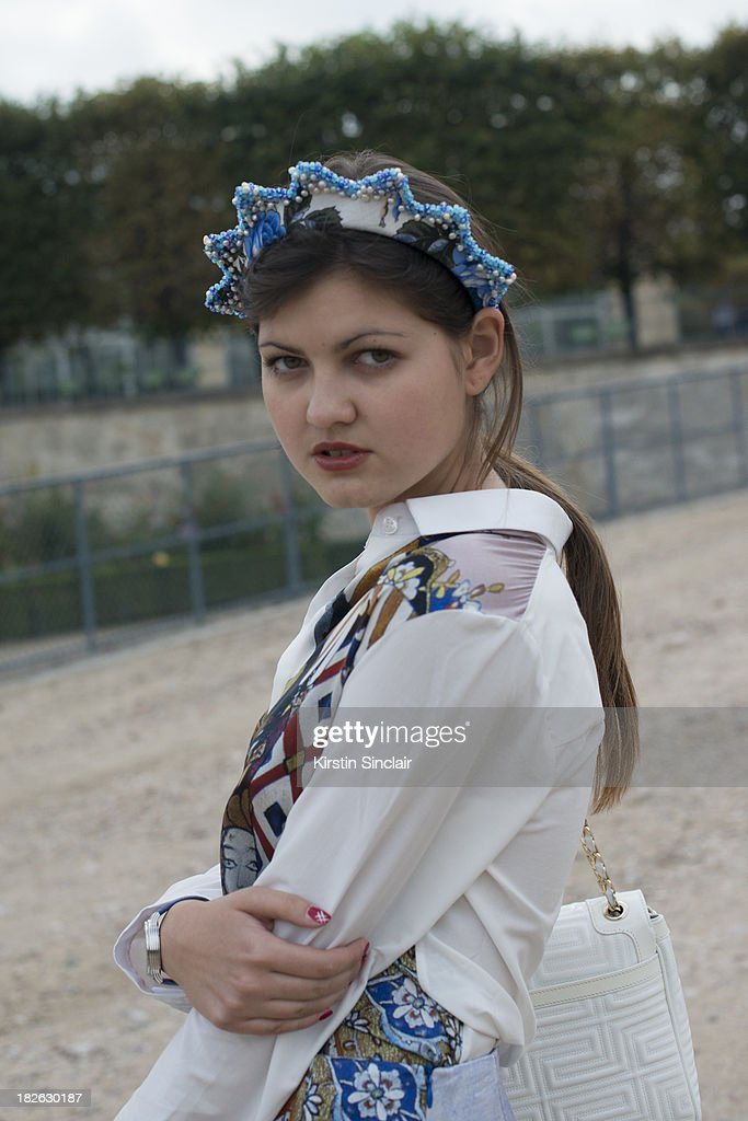 Fashion blogger Elvira Abasova wears Asli Filiuta dress, Givenchy bag and a Masterpiece headpiece on day 7 of Paris Fashion Week Spring/Summer 2014, Paris September 30, 2013 in Paris, France.