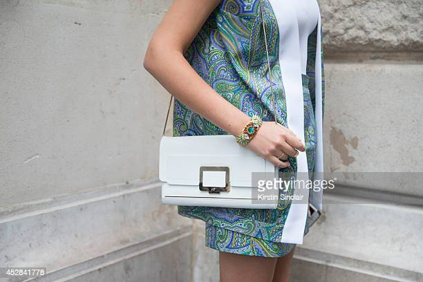 Fashion Blogger Elvira Abasova wears her own design top jacket and skirt Roger Vivier bag day 4 of Paris Haute Couture Fashion Week Autumn/Winter...