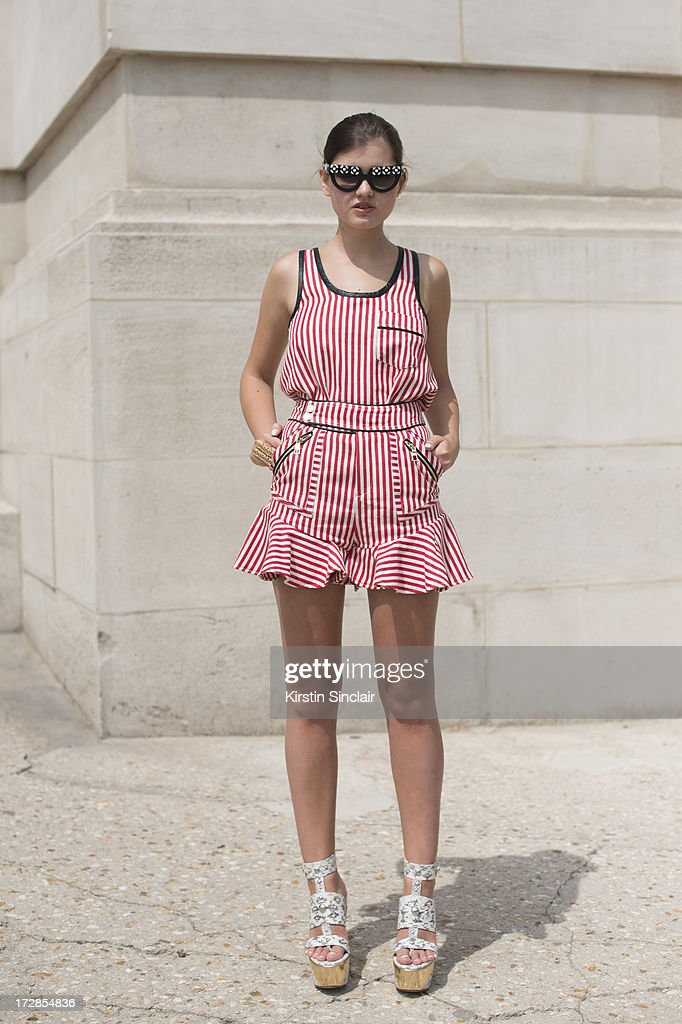 Fashion blogger Elvira Rezzonico wears Prada sunglasses, Three Floor playsuit and Jimmy Choo shoes on day 2 of Paris Collections: Womens Haute Couture on July 02, 2013 in Paris, France.
