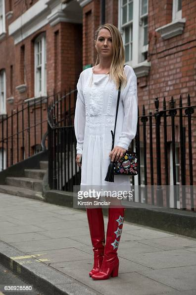 Fashion blogger Emilie Higgle wears Ralph Lauren dress Anya Hindmarch bag and Chiara Ferragni shoes on day 2 of London Womens Fashion Week...