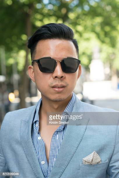 Fashion blogger Erwin Trinidad wears Gant sunglasses Polo Ralph Lauren shirt and a Burton jacket on day 3 of London Collections Men on June 11 2017...