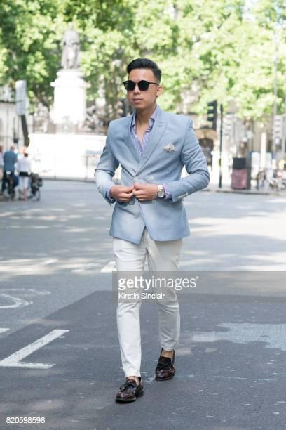 Fashion blogger Erwin Trinidad wears Gant sunglasses Polo Ralph Lauren shirt Next trousers Burton jacket Zara shoes and a Boom watch on day 3 of...