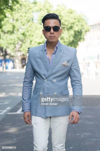 Fashion blogger Erwin Trinidad wears Gant sunglasses Polo Ralph Lauren shirt Next trousers Burton jacket and a Boom watch on day 3 of London...