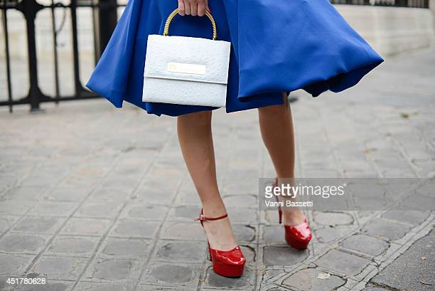 Fashion blogger Eva Ana Kazic poses wearing a B Polanec skirt and All around Eve bag before Atelier Versace on July 6 2014 in Paris France