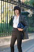 Fashion Blogger Evangelie Smyrniotaki wears a Chanel bag and Saint Laurent jacket shirt and trousers on day 2 during Paris Fashion Week Spring/Summer...