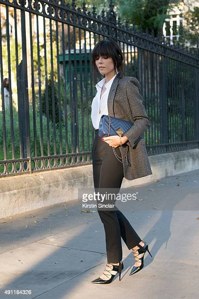 Fashion Blogger Evangelie Smyrniotaki wears a Chanel bag Saint Laurent jacket shirt and trousers and Jimmy Choo shoes on day 2 during Paris Fashion...