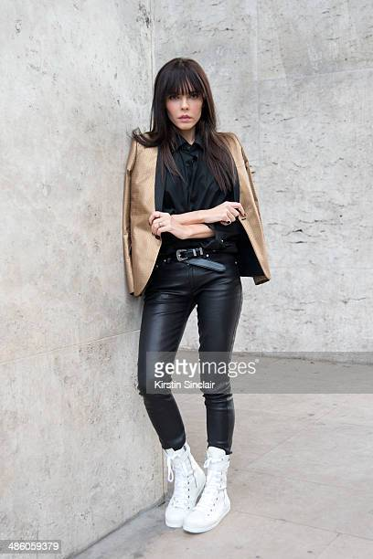 Fashion Blogger Evangelie Smyrniotaki wears a Saint Laurent jacket Acne trousers Ann Demeulemeester trainers and custom made shirt on day 5 of Paris...