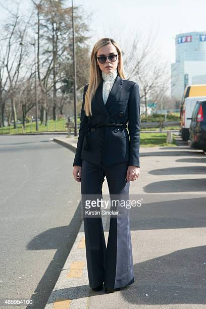Fashion blogger Evangelie Smyrniotaki wears all Celine Saint Laurent shoes Ray Ban sunglasses on day 6 of Paris Collections Women on March 08 2015 in...