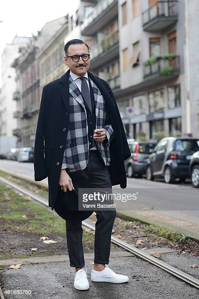 Fashion blogger Fabrizio Oriani poses wearing a Grifoni coat Christian Pellizzari jacket and Pt01 pants on January 17 2015 in Milan Italy