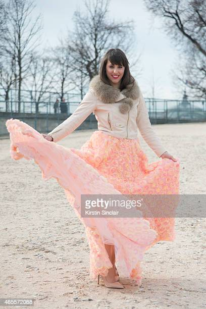 Fashion blogger Festy wears an H and M jacket and Priston dress on day 5 of Paris Collections Women on March 07 2015 in Paris France