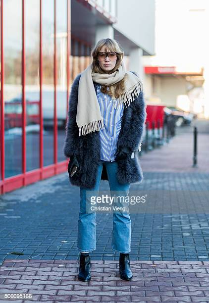 Fashion blogger Fiona Jane wearing Acne shoes Monki jeans vintage shirt coat Style butler glasses Loewe Prada bag outside Perret Schaad during the...