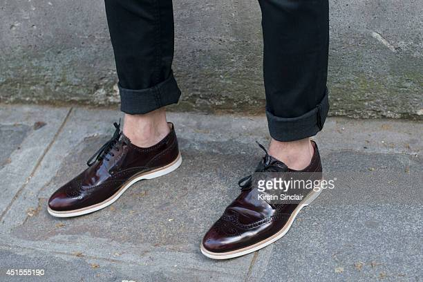 Fashion blogger for Infashionity Henry Obalit wearing Zara jeans and Louis Vuitton shoes on day 1 of Paris Collections Men on June 25 2014 in Paris...