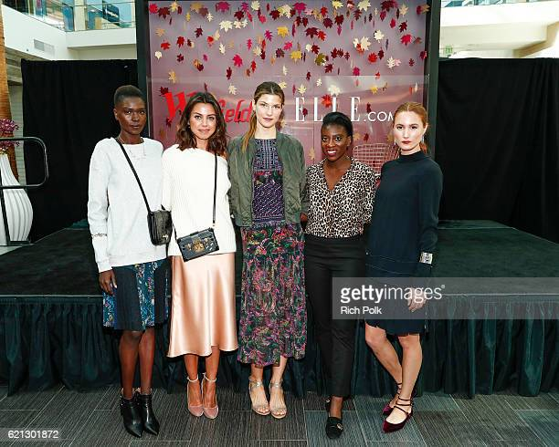 Fashion blogger for VivaLuxury Annabelle Fleur and Nikki Ogunnaike Senior Fashion Editor for Elle pose for a photo with the event models at the...