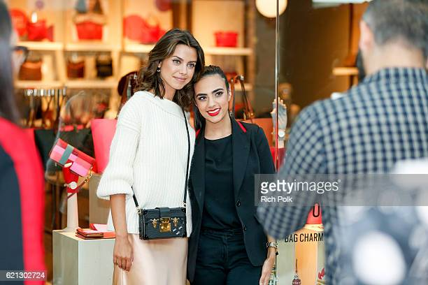 Fashion blogger for VivaLuxury Annabelle Fleur poses for a photo with a guest at the Westfield Topanga x Ellecom Fall Trend Report at Westfield...