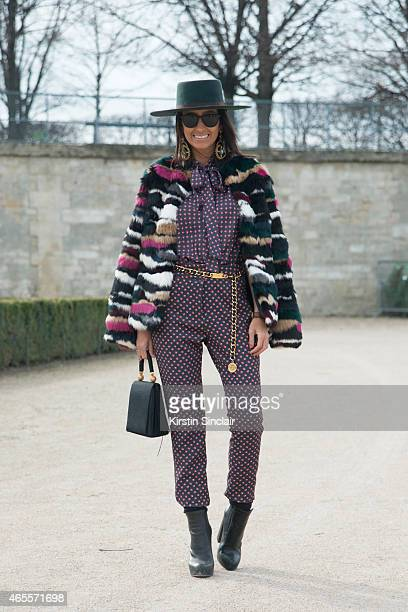 Fashion blogger Francesca Monfrinatti wears a Loft 747 hat Mes jacket vintage Moschino bag Amaro jumpsuit Camila Klein earrings and Alexander Wang on...