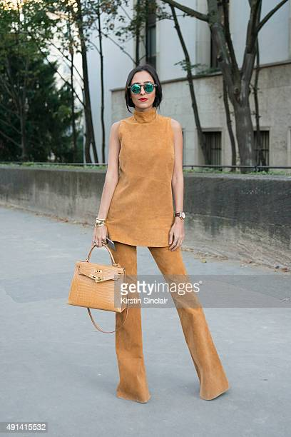 Fashion Blogger Francesca Monfrinatti wears a Loft 747 top and trousers Hermes bag Rolex watch Tiffany bracelet and Lamu Italy sunglasses on day 4 of...