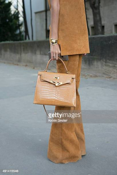 Fashion Blogger Francesca Monfrinatti wears a Loft 747 top and trousers Hermes bag Rolex watch and a Tiffany bracelet on day 4 of Paris Collections...
