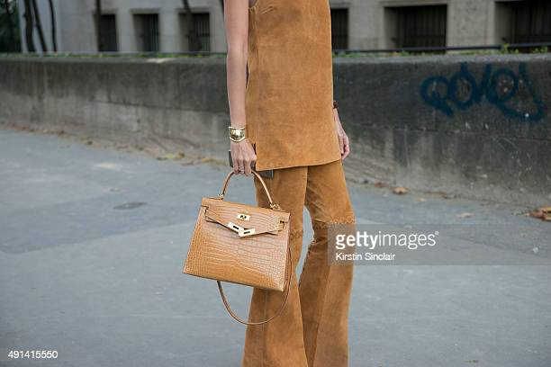 Fashion Blogger Francesca Monfrinatti wears a Loft 747 top and trousers Hermes bag Rolex watch and Tiffany bracelet on day 4 of Paris Collections...