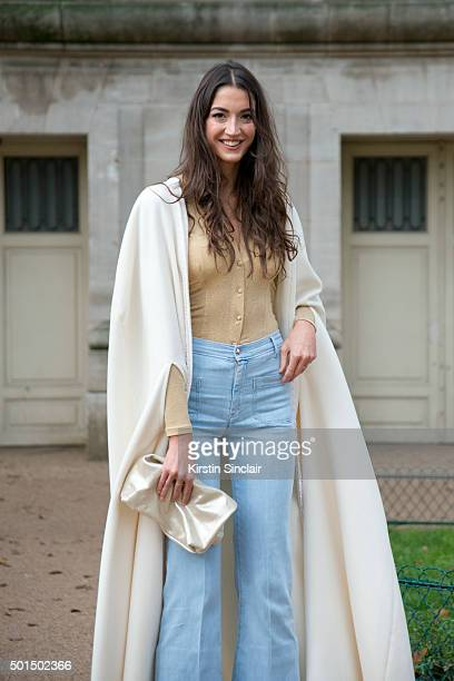 Fashion blogger from the Lipstick Sisters Sara Nicole wears 7 jeans vintage top Violet bag and The Lipstick Sisters cape on day 8 during Paris...