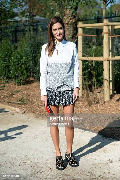 Fashion Blogger Gala Gonzalez is wearing Sandro shoes and Davidelfin top and skirt on day 9 of Paris Collections Women on October 01 2014 in Paris...