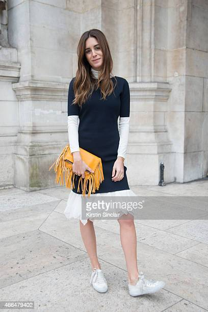 Fashion blogger Gala Gonzalez wears a Carolina Herrera dress and bag and Pedro Garcia shoes on day 7 of Paris Collections Women on March 09 2015 in...